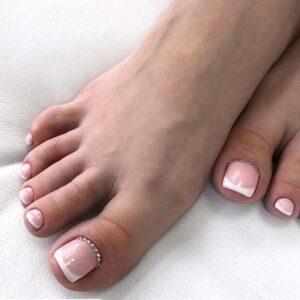 French pedicure with rhinestones