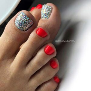 Red with glittery silver nails