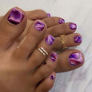 Purple marble toe nail design