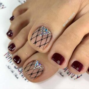 Burgundy nails accompanied by lace nail art