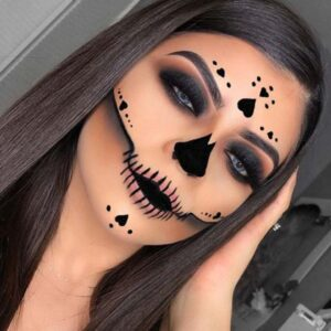 Black skull makeup with hearts